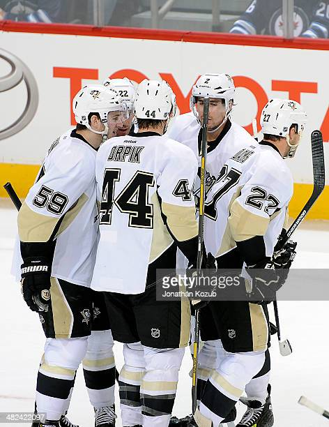 Jayson Megna Lee Stempniak Brooks Orpik Matt Niskanen and Craig Adams of the Pittsburgh Penguins celebrate a second period goal against the Winnipeg...