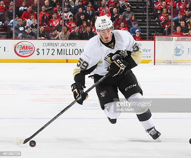 Jayson Megna of the Pittsburgh Penguins plays the puck against the New Jersey Devils during the game at the Prudential Center on December 29 2014 in...