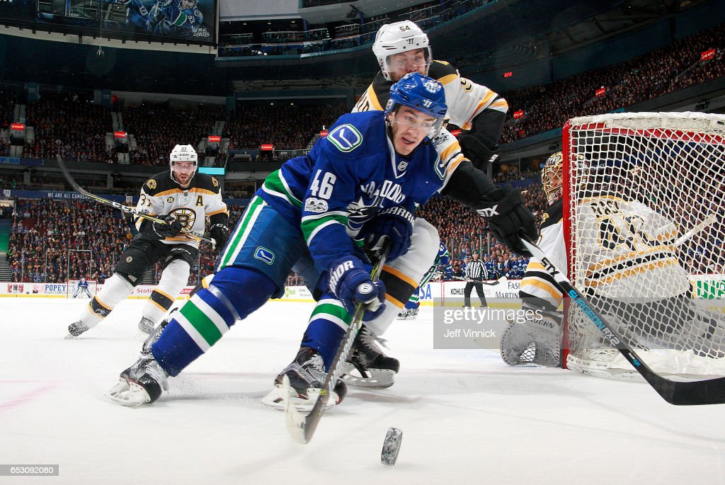 Jayson Megna #46 of the Vancouver Canucks and Adam McQuaid #54 of the Boston Bruins battle for a loose puck during their NHL game at Rogers Arena March 13, 2017 in Vancouver, British Columbia, Canada. Boston won 6-3.