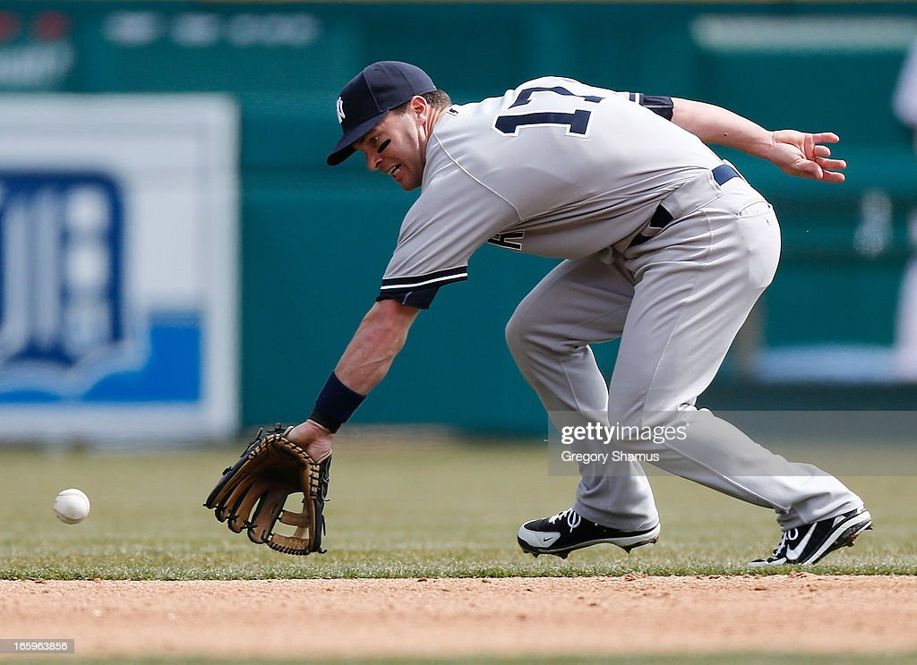 <a gi-track='captionPersonalityLinkClicked' href=/galleries/search?phrase=Jayson+Nix&family=editorial&specificpeople=836132 ng-click='$event.stopPropagation()'>Jayson Nix</a> #17 of the New York Yankees fields a eighth inning ground ball but can't catch the runner at first base while playing the Detroit Tigersat Comerica Park on April 7, 2013 in Detroit, Michigan. New York won the game 7-0.
