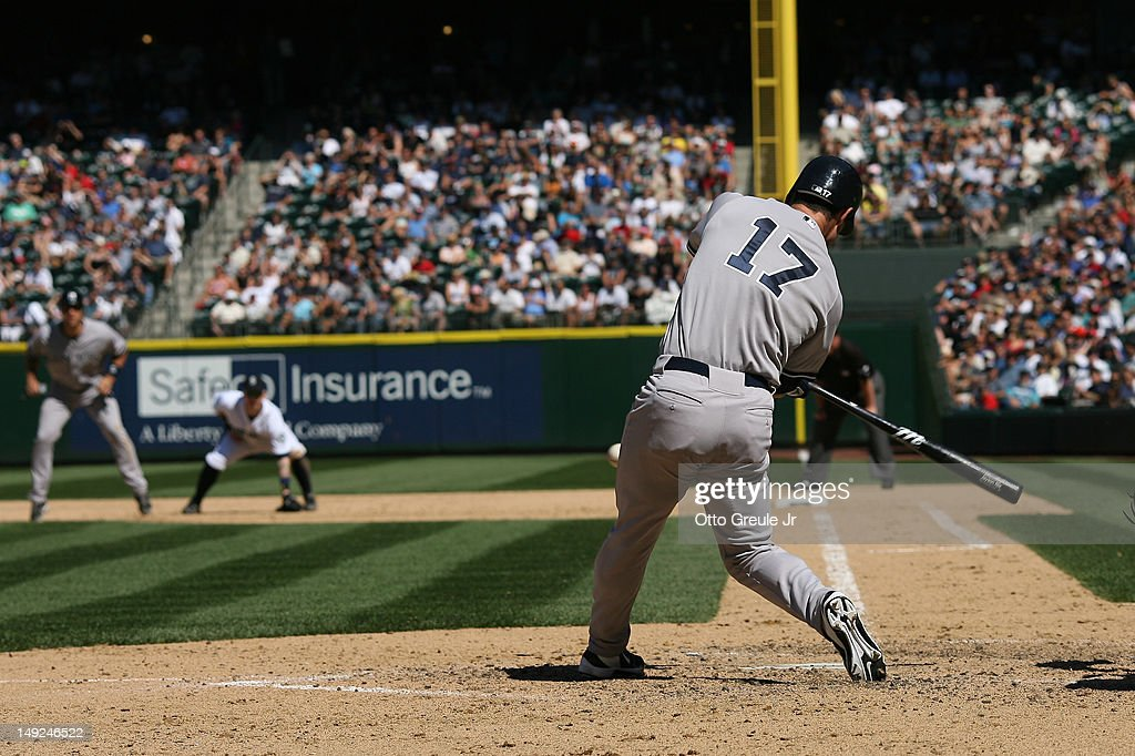 Jayson Nix #17 of the New York Yankees hits a three-RBI double against the Seattle Mariners at Safeco Field on July 25, 2012 in Seattle, Washington.