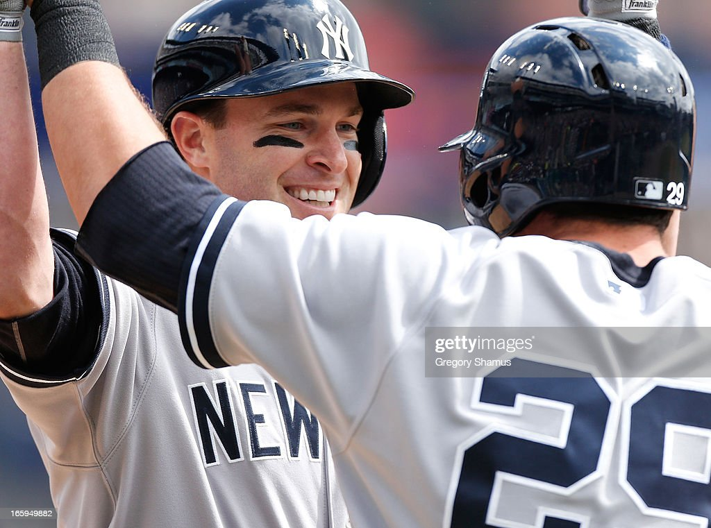 Jayson Nix #17 of the New York Yankees is congratulated at home plate by Francisco Cervelli #29 after hitting a third inning home run while playing the Detroit Tigers at Comerica Park on April 7, 2013 in Detroit, Michigan.