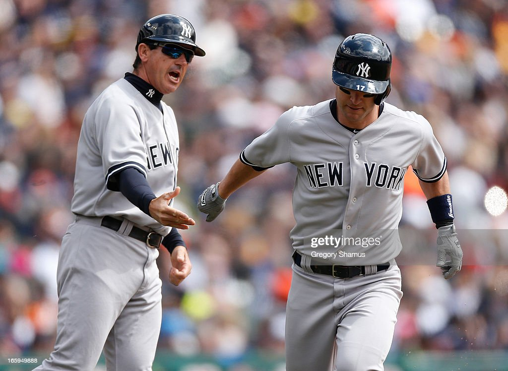 Jayson Nix #17 of the New York Yankees is congratulated by third base coach Rob Thomson after hitting a third inning home run while playing the Detroit Tigers at Comerica Park on April 7, 2013 in Detroit, Michigan.