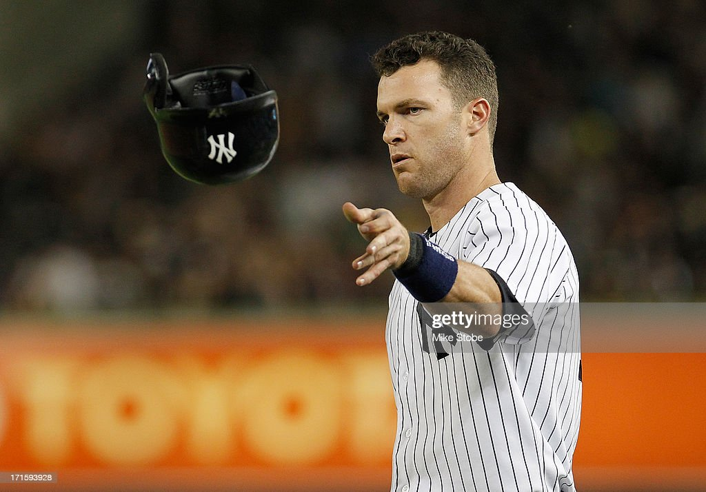 Jayson Nix #17 of the New York Yankees reacts after hitting into a double play with the bases loaded in the sixth inning against the Texas Rangers at Yankee Stadium on June 26, 2013 in the Bronx borough of New York City.