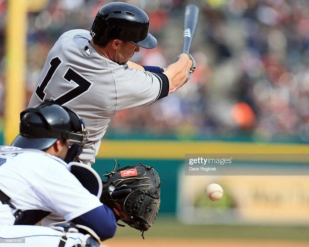<a gi-track='captionPersonalityLinkClicked' href=/galleries/search?phrase=Jayson+Nix&family=editorial&specificpeople=836132 ng-click='$event.stopPropagation()'>Jayson Nix</a> #17 of the New York Yankees swings and misses in front of <a gi-track='captionPersonalityLinkClicked' href=/galleries/search?phrase=Alex+Avila&family=editorial&specificpeople=5749211 ng-click='$event.stopPropagation()'>Alex Avila</a> #13 of the Detroit Tigers at Comerica Park on April 6, 2013 in Detroit, Michigan. The Tigers won 8-4
