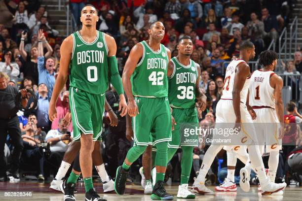 Jayson Tatum Al Horford and Marcus Smart of the Boston Celtics walk off the cour against the Cleveland Cavaliers on October 17 2017 at Quicken Loans...