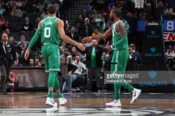 Jayson Tatum and Kyrie Irving of the Boston Celtics shake hands during the game against the Brooklyn Nets on November 14 2017 at Barclays Center in...