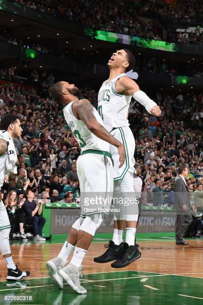 Jayson Tatum and Marcus Morris of the Boston Celtics react during the game against the Charlotte Hornets on November 10 2017 at the TD Garden in...