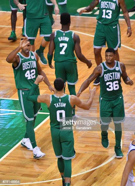 Jayson Tatum Marcus Smart and Al Horford of the Boston Celtics share a moment during the game against the Golden State Warriors on November 16 2017...