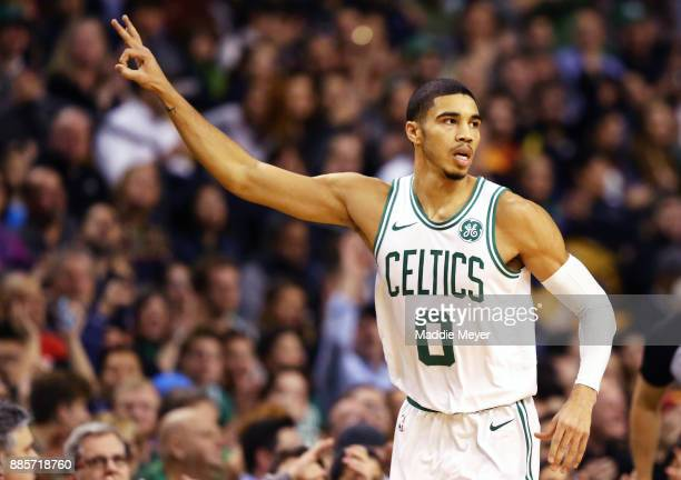 Jayson Tatum of the Boston Celtics celebrates after hitting a three point shot during the first quarter against the Milwaukee Bucks at TD Garden on...