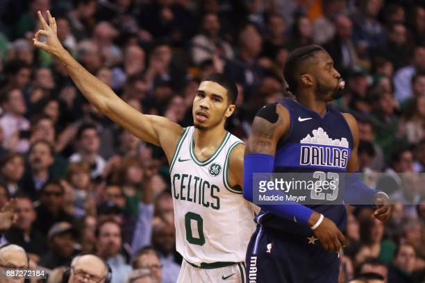 Jayson Tatum of the Boston Celtics celebrates after scoring a three point basket during the second quarter against the Dallas Mavericks at TD Garden...