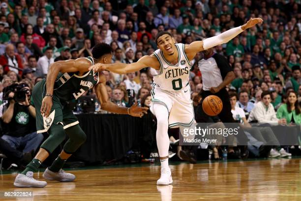 Jayson Tatum of the Boston Celtics dives for a loose ball during the fourth quarter against the Milwaukee Bucks at TD Garden on October 18 2017 in...