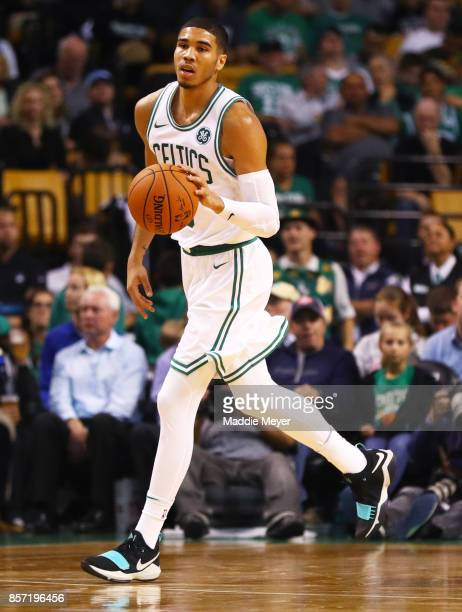 Jayson Tatum of the Boston Celtics dribbles against the Charlotte Hornets during the second half at TD Garden on October 2 2017 in Boston...