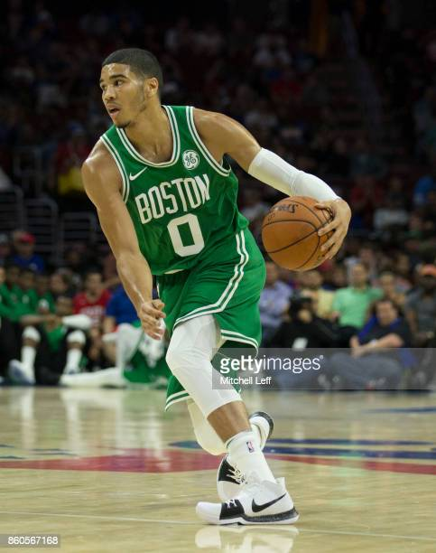 Jayson Tatum of the Boston Celtics dribbles the ball against the Philadelphia 76ers at the Wells Fargo Center on October 6 2017 in Philadelphia...