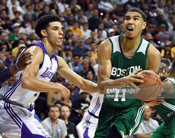 Jayson Tatum of the Boston Celtics drives against Lonzo Ball of the Los Angeles Lakers during the 2017 Summer League at the Thomas Mack Center on...