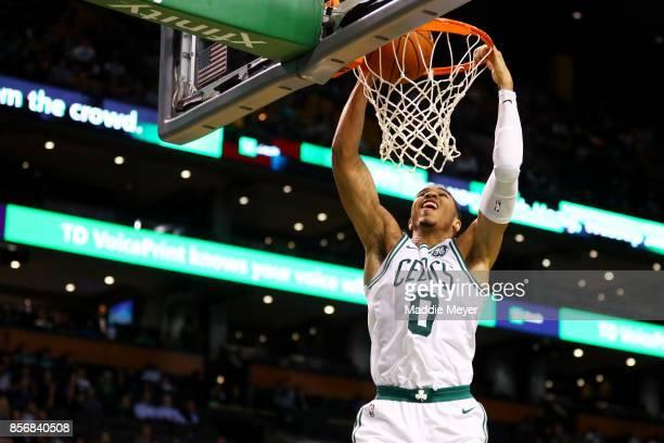 Jayson Tatum of the Boston Celtics dunks against the Charlotte Hornets during the second half at TD Garden on October 2 2017 in Boston Massachusetts...