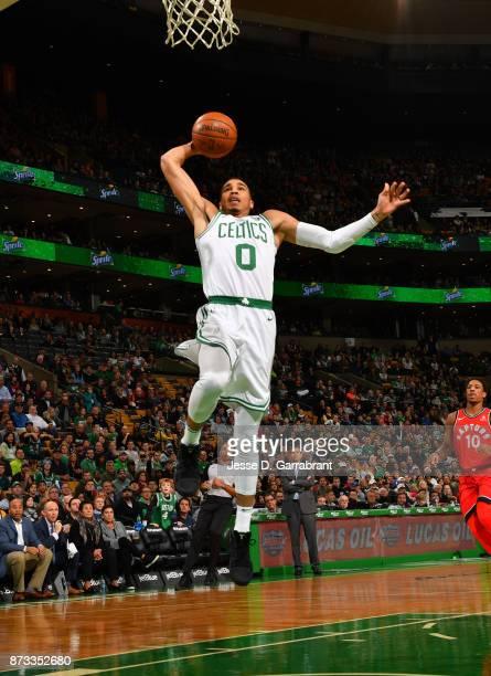Jayson Tatum of the Boston Celtics dunks the ball during the game against the Toronto Raptors on November 12 2017 at the TD Garden in Boston...