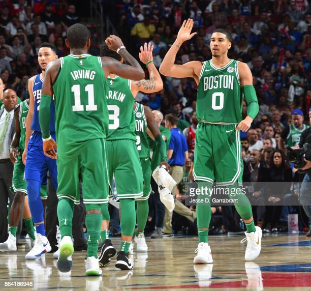 Jayson Tatum of the Boston Celtics give high fives during the game against the Philadelphia 76ers on October 20 2017 at Wells Fargo Center in...