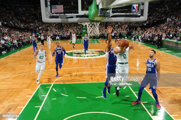 Jayson Tatum of the Boston Celtics goes for a lay up against the Philadelphia 76ers on November 30 2017 at the TD Garden in Boston Massachusetts NOTE...