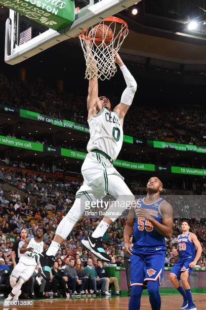 Jayson Tatum of the Boston Celtics goes to the basket against the New York Knicks on October 24 2017 at the TD Garden in Boston Massachusetts NOTE TO...