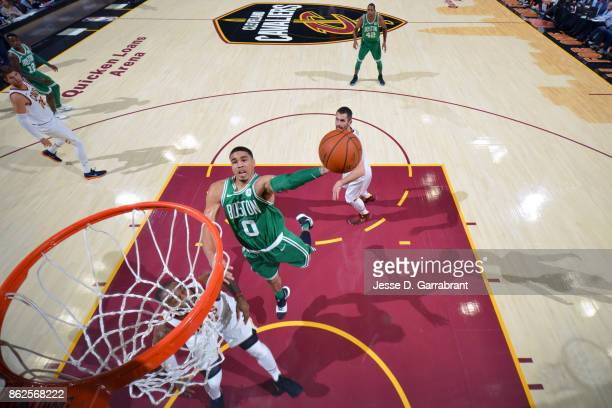Jayson Tatum of the Boston Celtics goes to the basket against the Cleveland Cavaliers on October 17 2017 at Quicken Loans Arena in Cleveland Ohio...