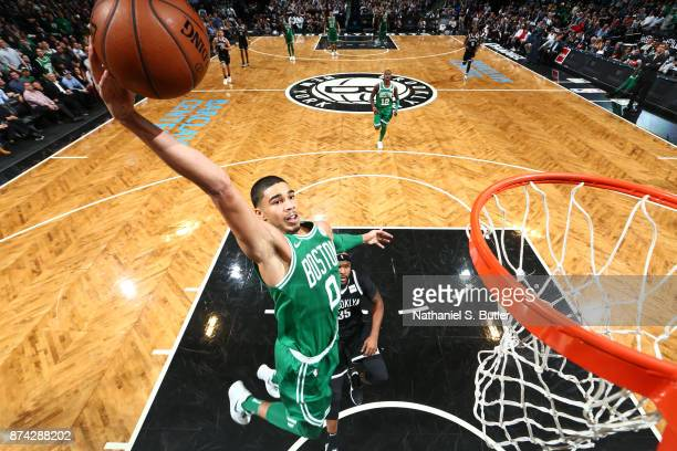 Jayson Tatum of the Boston Celtics goes up for a dunk against the Brooklyn Nets on November 14 2017 at Barclays Center in Brooklyn New York NOTE TO...