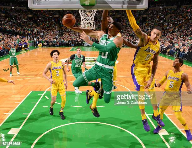 Jayson Tatum of the Boston Celtics goes up for the reverse layup during the game against the Los Angeles Lakers on November 8 2017 at the TD Garden...