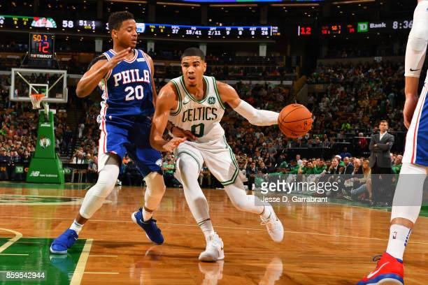 Jayson Tatum of the Boston Celtics handles the ball against the Philadelphia 76ers during a preseason game on October 9 2017 at TD Garden in Boston...