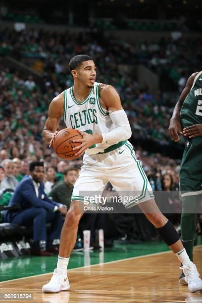 Jayson Tatum of the Boston Celtics handles the ball against the Milwaukee Bucks on October 18 2017 at the TD Garden in Boston Massachusetts NOTE TO...