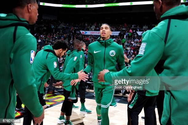 Jayson Tatum of the Boston Celtics high fives his teammates before the game against the Atlanta Hawks on November 18 2017 at Philips Arena in Atlanta...