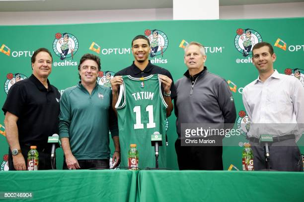 Jayson Tatum of the Boston Celtics holds his jersey as he poses for a picture with Wyc Grousbeck Stephen Pagliuca Brad Stevens and Danny Ainge of the...