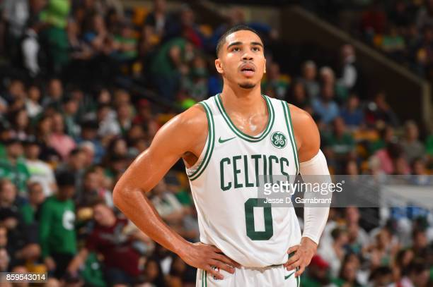 Jayson Tatum of the Boston Celtics looks on during a preseason game against the Philadelphia 76ers on October 9 2017 at TD Garden in Boston...