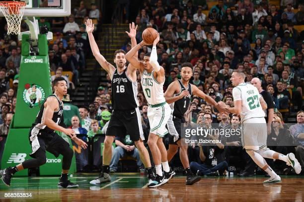 Jayson Tatum of the Boston Celtics passes the ball against the San Antonio Spurs on October 30 2017 at the TD Garden in Boston Massachusetts NOTE TO...