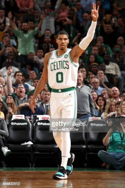 Jayson Tatum of the Boston Celtics reacts to scoring a 3 point backset against the Charlotte Hornets on October 2 2017 at the TD Garden in Boston...