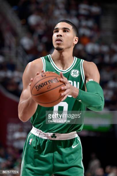 Jayson Tatum of the Boston Celtics shoots a free throw against the Cleveland Cavaliers on October 17 2017 at Quicken Loans Arena in Cleveland Ohio...