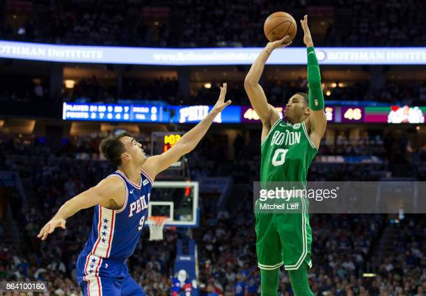 Jayson Tatum of the Boston Celtics shoots the ball against Dario Saric of the Philadelphia 76ers in the second quarter at the Wells Fargo Center on...
