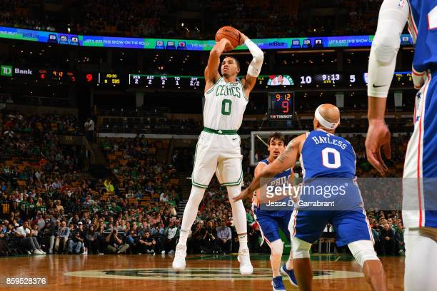 Jayson Tatum of the Boston Celtics shoots the ball against the Philadelphia 76ers during a preseason game on October 9 2017 at TD Garden in Boston...