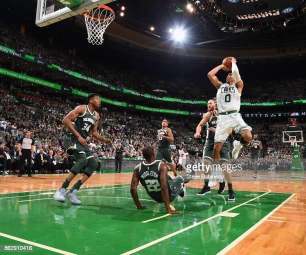 Jayson Tatum of the Boston Celtics shoots the ball against the Milwaukee Bucks on October 18 2017 at the TD Garden in Boston Massachusetts NOTE TO...