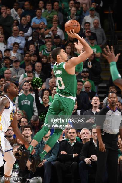 Jayson Tatum of the Boston Celtics shoots the ball against the Golden State Warriors on November 16 2017 at the TD Garden in Boston Massachusetts...