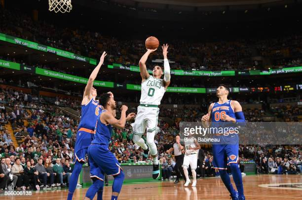 Jayson Tatum of the Boston Celtics shoots the ball against the New York Knicks on October 24 2017 at the TD Garden in Boston Massachusetts NOTE TO...