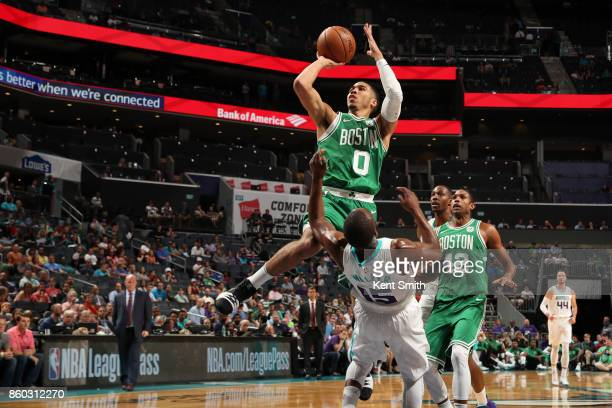 Jayson Tatum of the Boston Celtics shoots the ball against the Charlotte Hornets on October 11 2017 at Spectrum Center in Charlotte North Carolina...