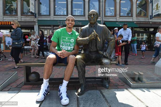 Jayson Tatum of the Boston Celtics takes a photo with a statue of Red Auerbach during a tour around Boston Massachusetts on August 24 2017 NOTE TO...