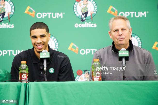 Jayson Tatum of the Boston Celtics talks with the media along with Danny Ainge of the Boston Celtics during a introductory press conference on June...