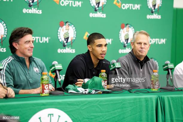 Jayson Tatum of the Boston Celtics talks with the media along with Wyc Grousbeck and Danny Ainge of the Boston Celtics during a introductory press...