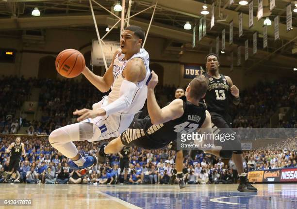 Jayson Tatum of the Duke Blue Devils collides with Trent VanHorn of the Wake Forest Demon Deacons during their game at Cameron Indoor Stadium on...
