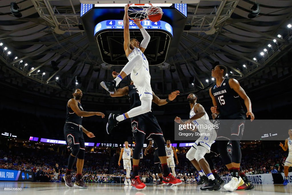 Jayson Tatum #0 of the Duke Blue Devils dunks the ball in the first half against the South Carolina Gamecocks during the second round of the 2017 NCAA Men's Basketball Tournament at Bon Secours Wellness Arena on March 19, 2017 in Greenville, South Carolina.