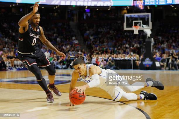 Jayson Tatum of the Duke Blue Devils trips in the first half against the South Carolina Gamecocks during the second round of the 2017 NCAA Men's...