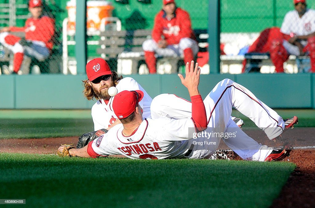 <a gi-track='captionPersonalityLinkClicked' href=/galleries/search?phrase=Jayson+Werth&family=editorial&specificpeople=206490 ng-click='$event.stopPropagation()'>Jayson Werth</a> #28 and <a gi-track='captionPersonalityLinkClicked' href=/galleries/search?phrase=Danny+Espinosa&family=editorial&specificpeople=4410764 ng-click='$event.stopPropagation()'>Danny Espinosa</a> #8 of the Washington Nationals slide for and miss a foul ball in the eighth inning against the Miami Marlins at Nationals Park on April 10, 2014 in Washington, DC.