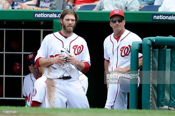 Jayson Werth and manager Jim Riggleman of the Washington Nationals talk during the game against the Philadelphia Phillies at Nationals Park on June 1...