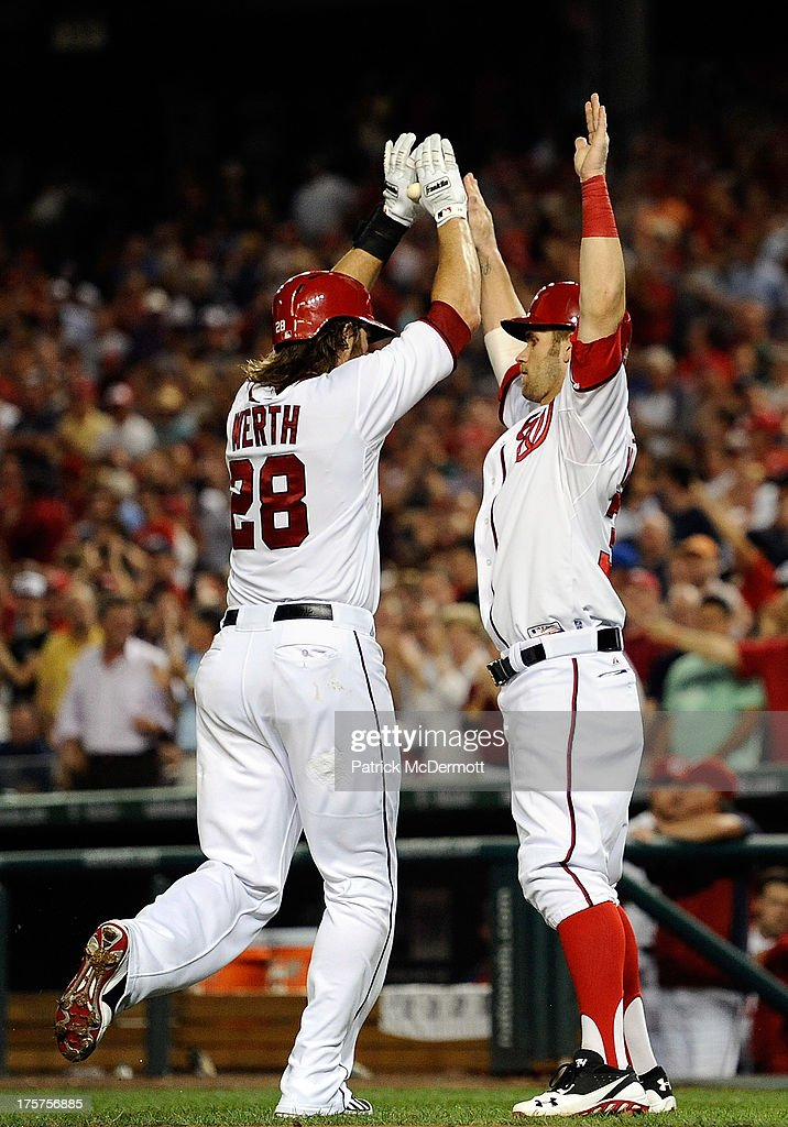 <a gi-track='captionPersonalityLinkClicked' href=/galleries/search?phrase=Jayson+Werth&family=editorial&specificpeople=206490 ng-click='$event.stopPropagation()'>Jayson Werth</a> #28 celebrates with <a gi-track='captionPersonalityLinkClicked' href=/galleries/search?phrase=Bryce+Harper&family=editorial&specificpeople=5926486 ng-click='$event.stopPropagation()'>Bryce Harper</a> #34 of the Washington Nationals after hitting a two-run home run in the fourth inning during a game against the Atlanta Braves at Nationals Park on August 7, 2013 in Washington, DC.